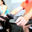 Royalty-Free Stock Vectorielle: Using Health Club Exercise Bikes