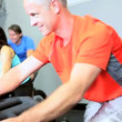 Stock Video: Multi Ethnic Group Riding Exercise Bike