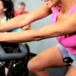 Keeping Fit on Modern Exercise Bike - Stock Photo