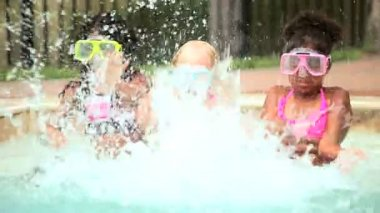 Diverse pre schoolgirls have fun in swimming pool — Stock Video
