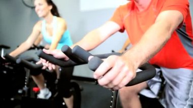 Using Health Club Exercise Bikes — Stock Video #18527135