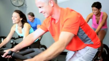 Multi Ethnic Group Riding Exercise Bike — Stock Video