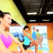 Stock Video: Health Club Members in Exercise Class