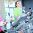 Stock Video: Using Gym Equipment