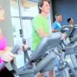 Stock Video: Exercising on Cross Trainers