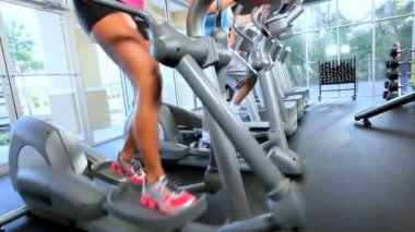 Exercising on Cross Trainers — Stockvideo