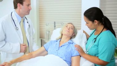 Doctor Treating Senior Female Patient — Stock Video