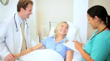 Doctor Treating Senior Female Patient — Stock Video #18546389