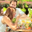 Caucasian Family Sharing Healthy Lunch Together - Stock Photo
