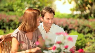 Couple Using Laptop Outdoors — Stock Video