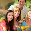 Caucasian Family Sitting Home Garden - Stock Photo