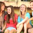 Vídeo Stock: Young Family Talking Together Front garden