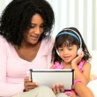 African American Mother Child Wireless Tablet - Stock Photo