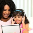 Royalty-Free Stock Imagem Vetorial: Close Up Ethnic Mom Child Using Tablet Technology