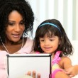 Portrait Mom Daughter Music Wireless Tablet - Stock Photo