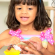 Pretty Mother Young Child Icing Cupcakes — Stock Video
