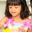 Stock Video: Cute Child Mom Decorating Cupcakes