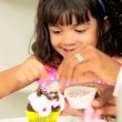 Stock Video: Little Ethnic Girl Young Mom Pretend Baking