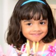 Stock Video: Cute Child Mom Putting Candles on Cakes