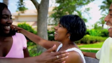 Young African American parents greeting teenage daughter joining them garden shot on RED EPIC