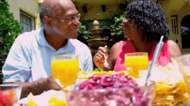 Mature Ethnic Couple Sharing Healthy Lunch Together — 图库视频影像