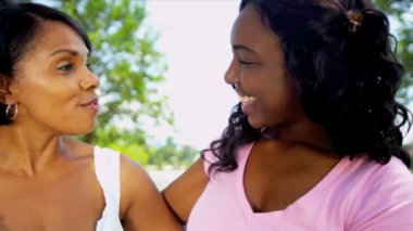 Teenage African American Girl Talking Mother Outdoors — Stock Video
