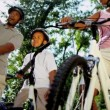 Young Ethnic Family Cycling Together — Stockvideo