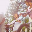 Stock Video: Ethnic Family Enjoying Cycling Together
