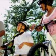 Healthy Fit Ethnic Family Cycling Suburban Roads — Stock Video #18771219