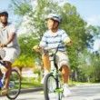 Healthy Ethnic Family Bike Riding Together — Stock Video