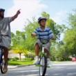 African American Family Riding Bicycles — Stock Video #18772773