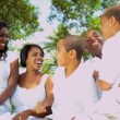 Ethnic Parents Laughing Children Outdoors — Stock Video
