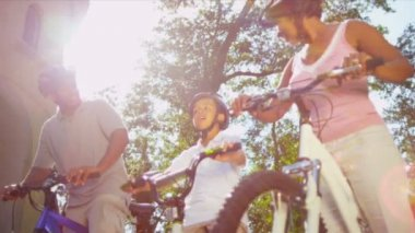 Ethnic Family Enjoying Cycling Together — Stockvideo
