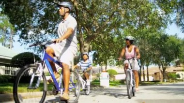 Healthy Fit Ethnic Family Cycling Suburban Roads — Vídeo de stock