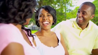 Close Up Ethnic Parents Laughing Teenage Daughter Outdoors — Stock Video