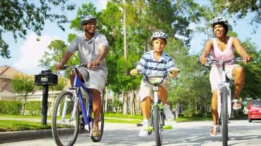 Young African American family exercising together out cycling shot on RED EPIC