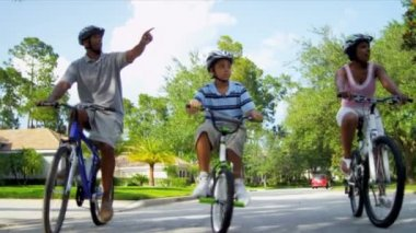 African American Family Riding Bicycles — Stockvideo