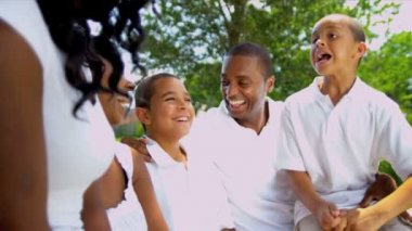 Ethnic Parents Laughing Children Outdoors Together — Vídeo de stock #18776349