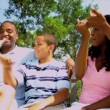 Ethnic Parents Laughing Family Outdoors — Stock Video #18781095