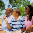 African American Family Welcoming Young Sons Outdoors — Stock Video #18781389