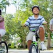 Stock Video: Healthy Fit Ethnic Family Cycling SuburbRoads