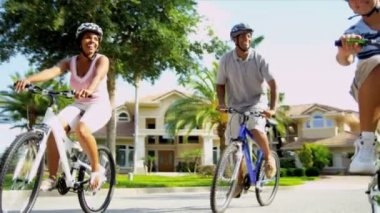African American Parents Son Riding Bicycles — Stock Video #18784813