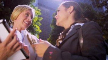 Businesswomen using wireless tablet — Stock Video