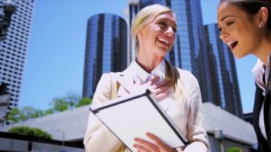 Female businesswomen using wireless tablet — Stock Video
