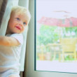 Stock Video: Caucasian Baby Hiding Behind Curtains