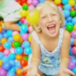 Stock Video: Little Caucasian Girl in Ball Pool