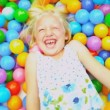 Stock Video: Caucasian Child Playing Ball Pool