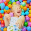 Cute Blonde Child Enjoying Ball Pool — Stock Video #18889349