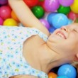 Laughing Little Girl Playing Plastic Balls — Stock Video #18889721