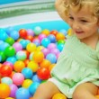 Cute Blonde Child Enjoying Ball Play - Stock Photo